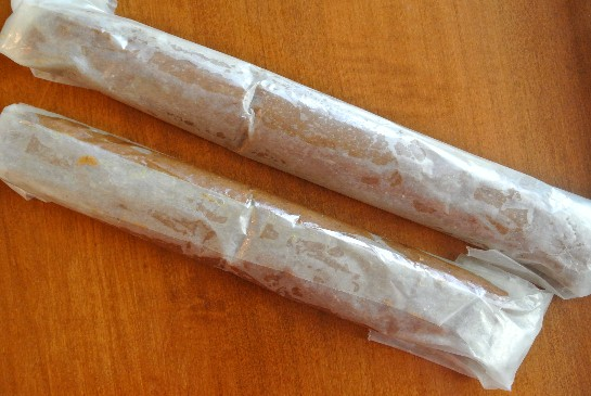 Cookie Dough is rolled up in two logs and ready to be placed in  the refrigerator.