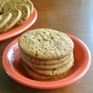 Almond Butter Refrigerator Cookies stacked high in an orange berry bowl.