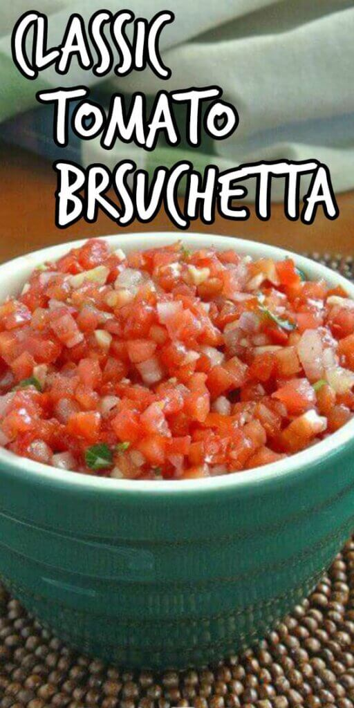 Finely dice tomato bruschetta filling a green bowl.