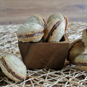 Chocolate filled cookies are piled into wooden bowls.
