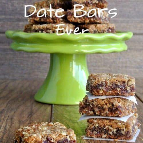 Stacks of date bars in front of a green compote with more on the plate.
