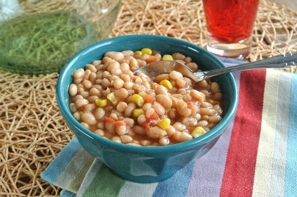Slow Cooker Navy Bean Soup is comfort food to the max and has the quality and flavors for all ages.