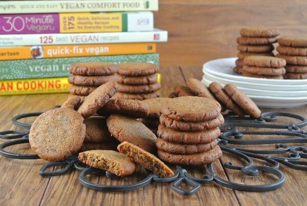 Cookies are stacked in piles on an iron trivel and a few are broken open to show the inside.