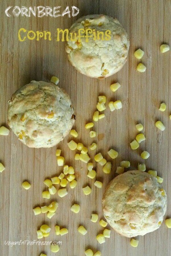 Overhead view od an alternative as cornbread muffins with corn kernals scattered around.