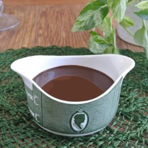 Chocolate in an antique green and white creamer.