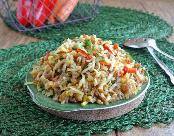 Rainbow Veggie HashBrowns Potatoes sound like springtime and are as colorful. Hashbrowns and thinly sliced veggies are all fried together. Quick and easy.