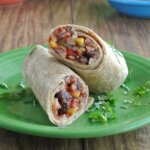 Slow Cooker Black Bean Burritos are easy and spicy with lots of texture. It all turns into a hearty meal with the addition of avocados and black olives.