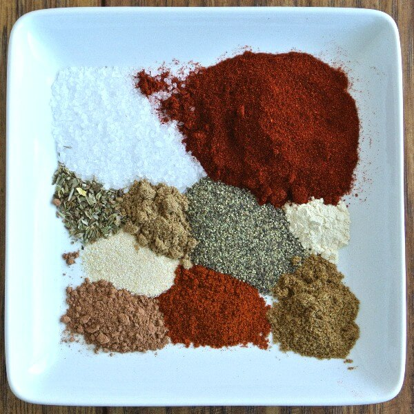 Taco Seasoning ingredients seprated on a white square plate.