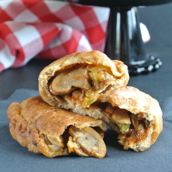 Vegan Empanadas have sauteed mushroom slices that are combined with sofrito as well as a refreshing tomato sauce.
