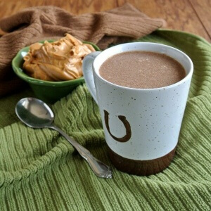 Slow Cooker Hot Chocolate goes in the crock pot, uses easy homemade chocolate syrup, can be drank hot first thing in the morning and ... can be drank cold.