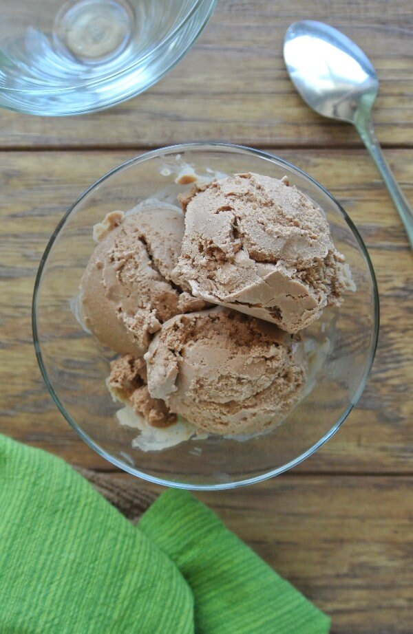 Overhead view of chocolate ice cream scooped into a flared glass.
