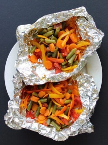 Foil Wrapped Grilled Vegetables are wrapped up in a little package along with herbs and spices.