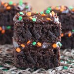 Double Chocolate Brownie Stacks are thin layers of brownies layered with rich chocolate frosting and then sprinkled with the colors of the season.