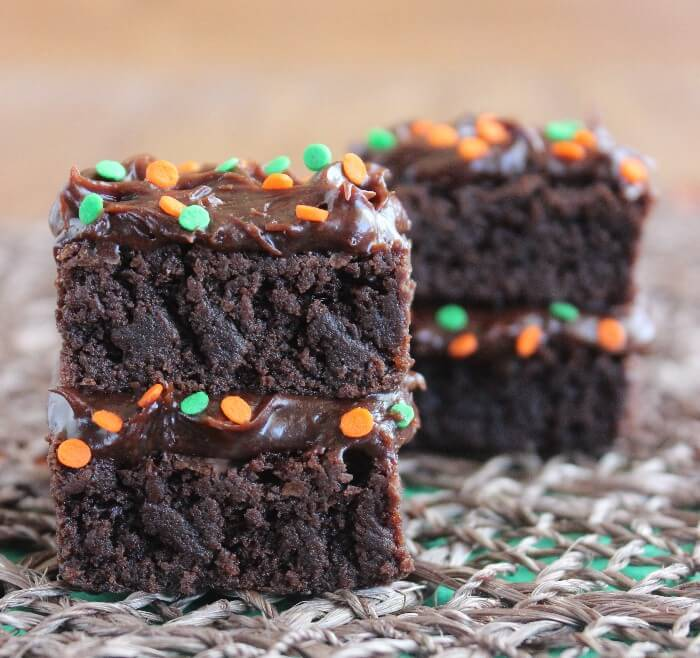 Double Chocolate Brownie Stacks are layers of brownies and rich chocolate frosting plus they are sprinkled with the colors of the season