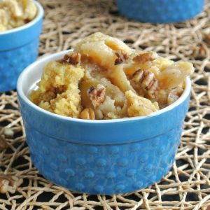 Golden apples cooked and piled in a blue bowl.