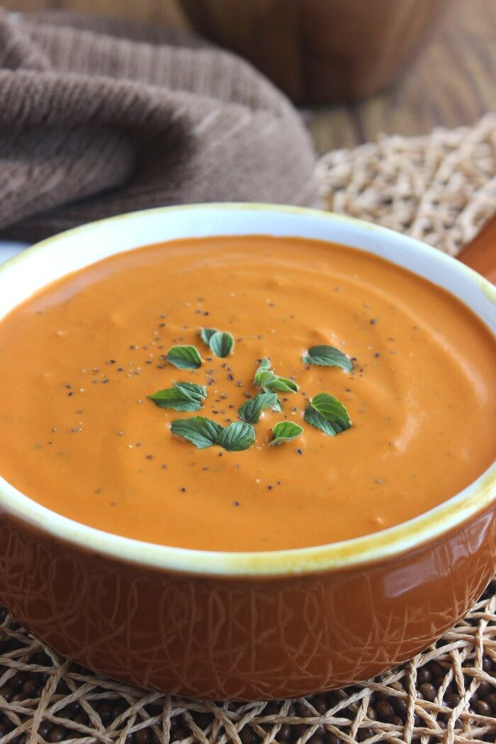 Rich Tomato Bisque is a classic soup that is simple to make but this recipe will make you think there should be a tablecloth on the dining table. Truthfully, paper napkins are just fine and the kids will love it too. The richness comes from coconut milk and the spices are varied. Comfort food at it's best.