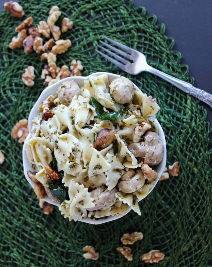 Company Worthy Bowtie Pasta Salad is all prettied up with a little extra veggies and spices. The dressing ingredients blend perfectly and melds the salad all together.