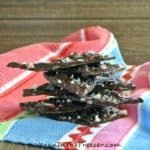 Chocolate Peppermint Bark is made with deep rich chocolate that has hints of a minty flavor and little bits of peppermint candy cane.