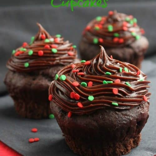 Christmas Chocolate Lava Cupcakes are dressed up for October. There is a creamy rich chocolate center that stays like that all the way to the last bite.