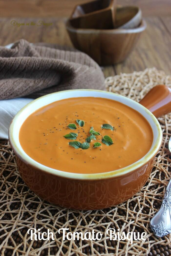 Rich Tomato Bisque is a classic soup that is simple to make. Creamy soup with tons of flavor that comes from puréed vegetables. Comfort food at it's best.