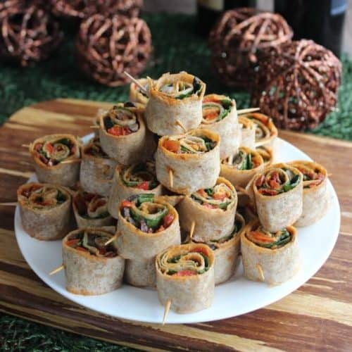 Spicy Tortilla Rollups with a close-up of the rolls with veggie layers showing at the downward angle.