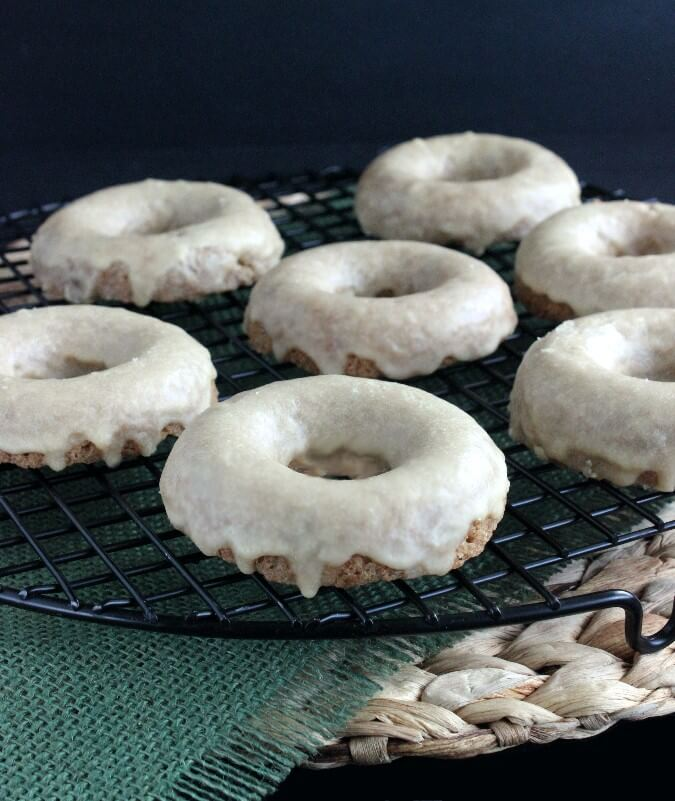 Baked Maple Glazed Donuts are baked into a really really good dense cakey donut. Dipped into a maple icing and you will be in bakery nirvana.