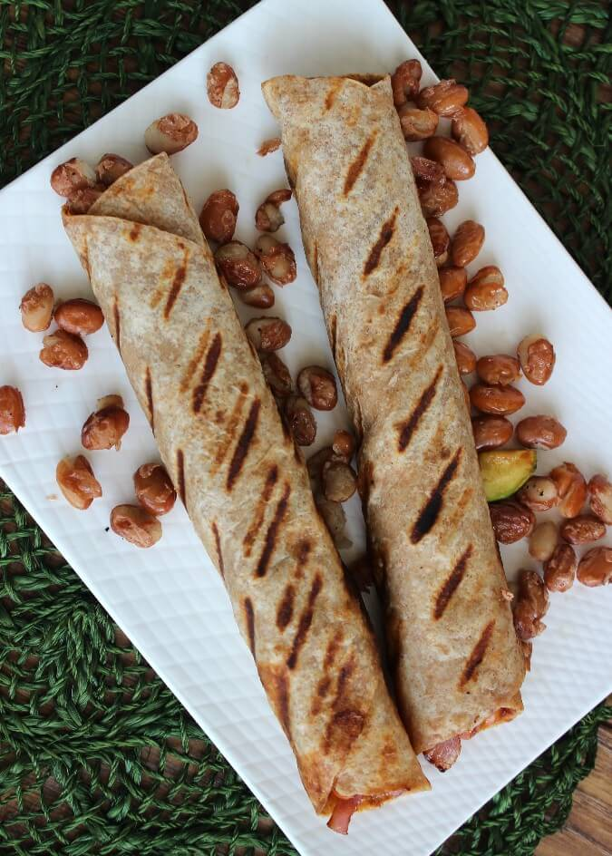 Grilled Barbecue Tortilla Wraps are lightly grilled and stuffed with pinto beans, barbecue sauce and more. Extremely inexpensive, easy and satisfying.
