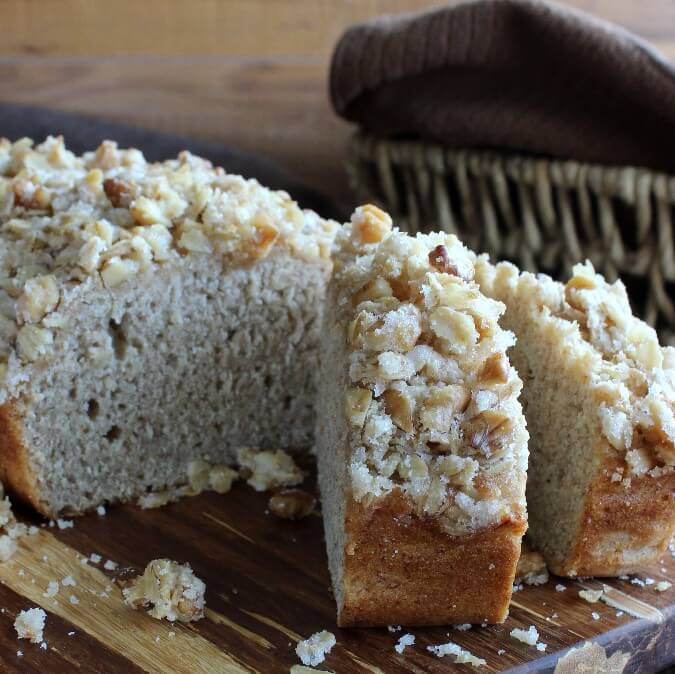 Breakfast Banana Cake is a simple and delicious quick bread that is as delicate as a cake. A chunky sweet mixture of cereal and nuts is also baked on top.