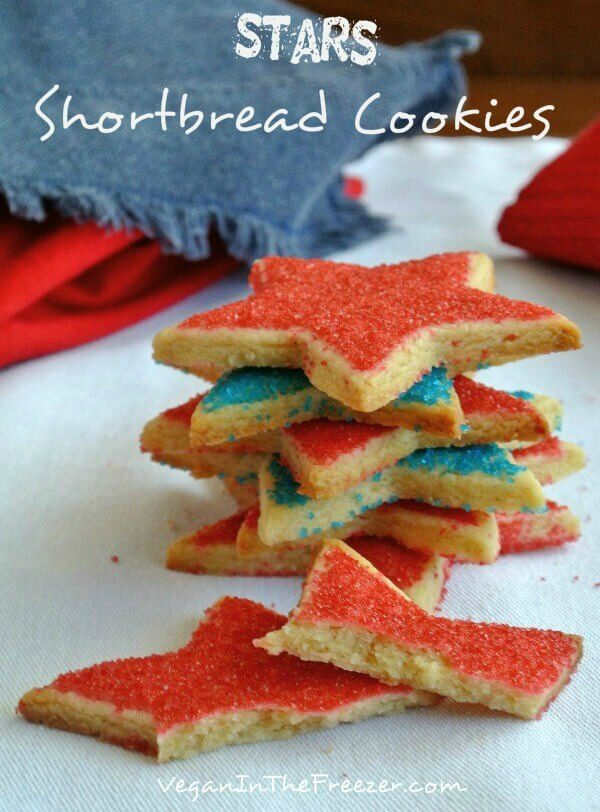 Stars Shortbread Cookies are sprinkled with red and blue sugar sprinkles and then stacked high with points pointing everywhere.