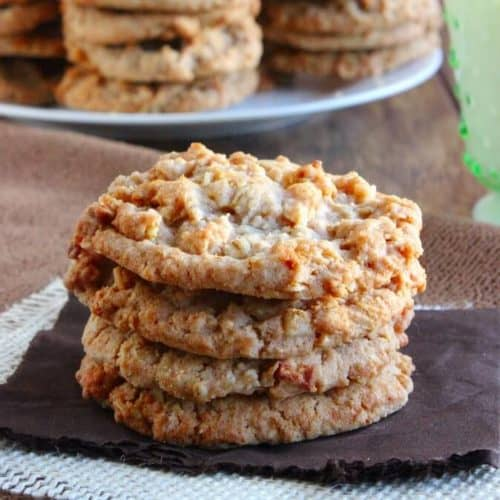 Stack of homemade fruity cookies on a brown napkin and beige burlap square. Pie Cookies may just be the perfect treat.