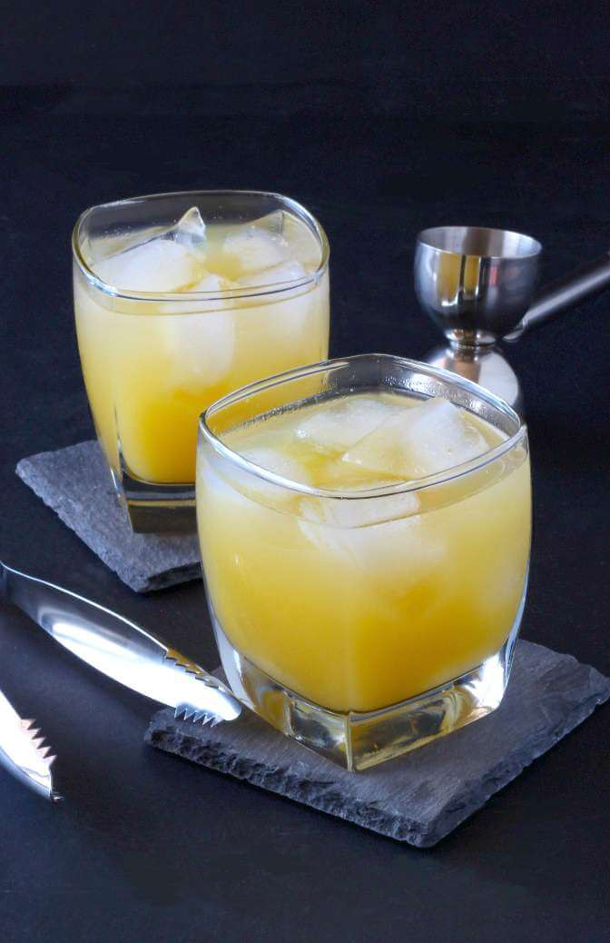 Crystallized Ginger Orange Juice Cocktail is a spicy sweet concoction that will have you wanting more.