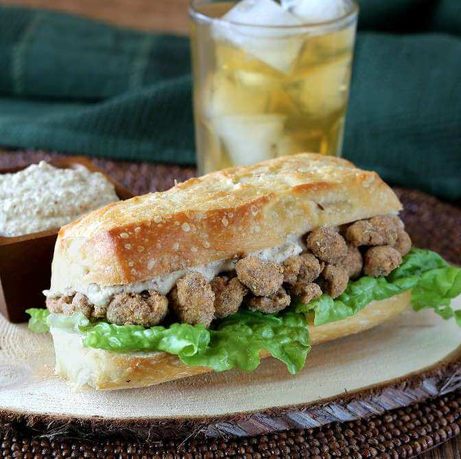 Cauliflower Po' Boy Sandwich is a hearty sandwich that is made from roasted cauliflower that has been drenched in a flavorful coating.
