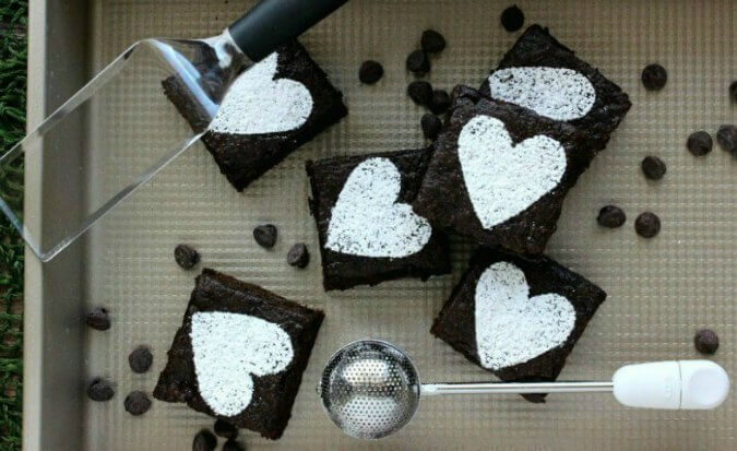 Double Chocolate Brownies are rich with chips of chocolate in every bite. Made with love and OXO's brownie pan, brownie spatula and dusting wand.
