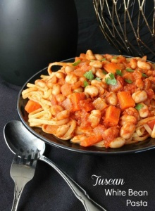 Tuscan White Bean Pasta is a comfort dinner that can be put together in no time. The best tomato sauce and vegetables are combined for a taste of Italy.