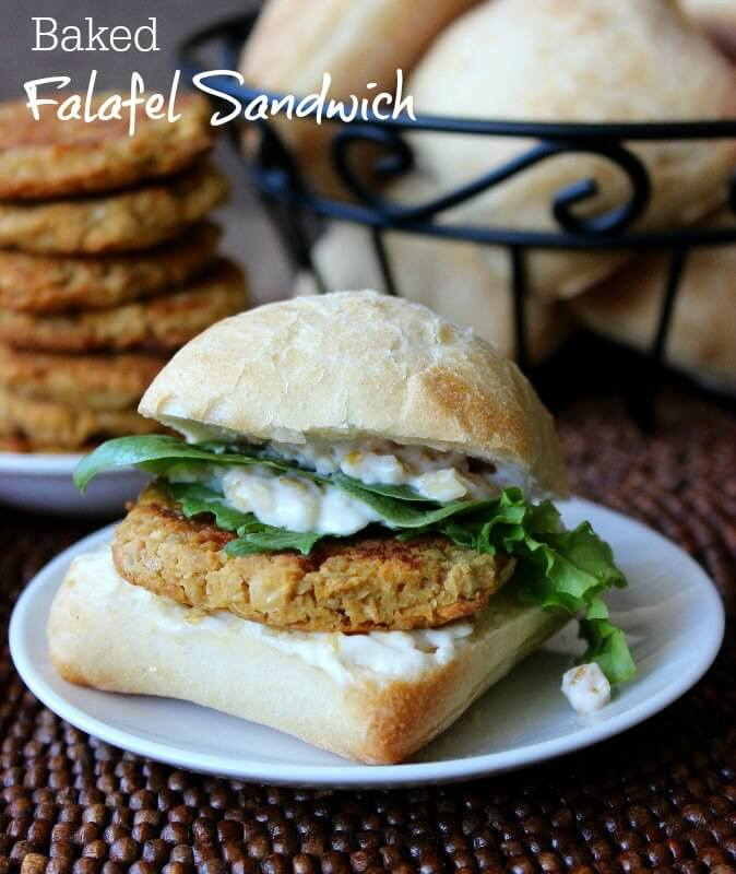 Sandwich bun filled with falafel and condiments.