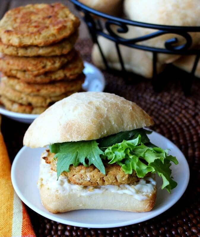 A bun filled with baked pattie with lettuce.