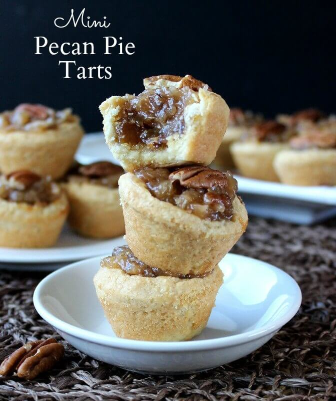 Mini Pecan Pie Tarts are over the top rich and perfect for the holidays. Enjoyed at any family gathering or through an elegant party.