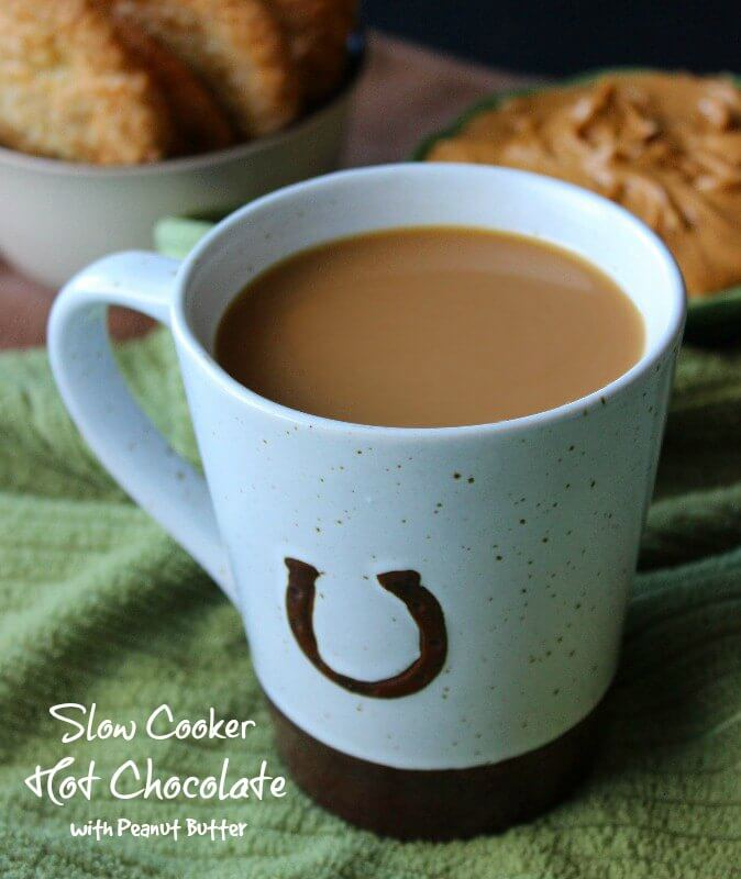 Slow Cooker Hot Chocolate with Peanut Butter goes in the crockpot with chocolate syrup. It is so easy and can be drank hot or cold!