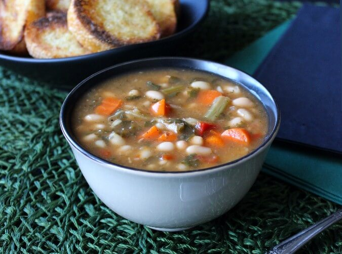 Kale White Bean Soup serves up a complete meal with this one recipe. An easy and delicious recipe that you need to make asap.
