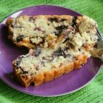 Glazed Lemon Blueberry Cake with a nice forkful just ready for the eating. Square photo for social media shares.