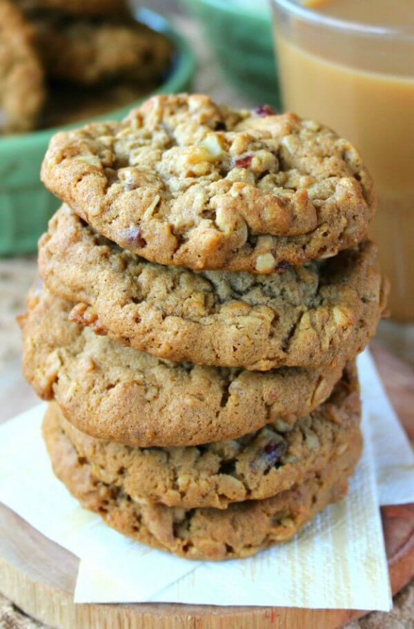 Dairy-Free Oatmeal Cranberry Cookies are stacked 5 cookie high with a very close-up photo to see all of the ingredients baked in.