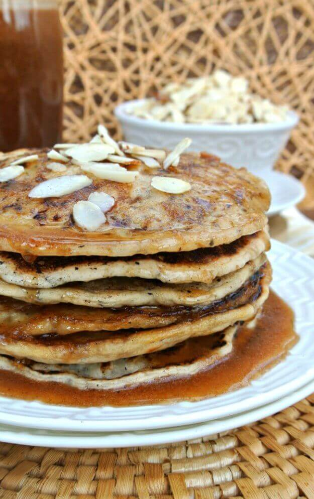 Vegan Buttermilk Pancakes with Almond Butter Maple Syrup stacked high and off center photo for a close up look.