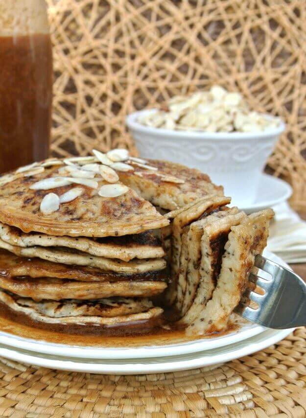 Vegan Buttermilk Pancakes with Almond Butter Maple Syrup are to-die-for and waiting for a great big bite. A big stack of six pancakes and a triangle of six layers on a fork.