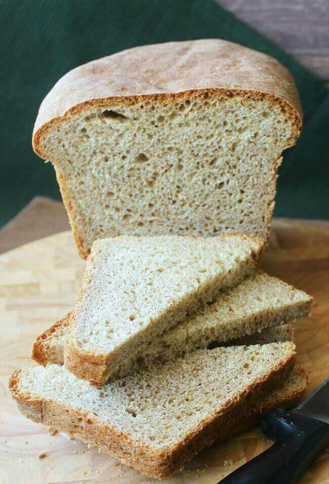 Rich Whole Wheat Batter Bread facing forward with slices sliced again in half.