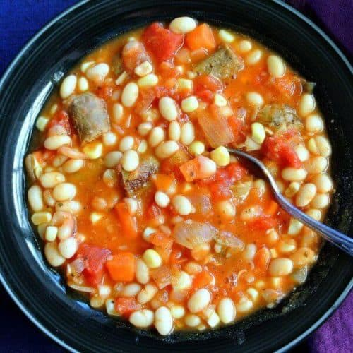 Vegan Bean Stew is a comfort food favorite. Fresh carrots, corn off the cob & to make it traditional there's also plant based sausage.