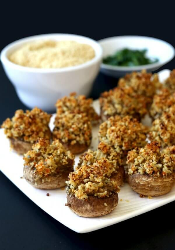 Holiday Stuffed Mushrooms are classically filled with a bit of grated carrot for a pretty and tasty recipe. A super simple side dish or appetizer.