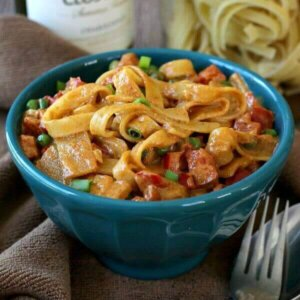 Thai Curry Fettuccine has a curry based sauce highlighted with bamboo shoots and peas.
