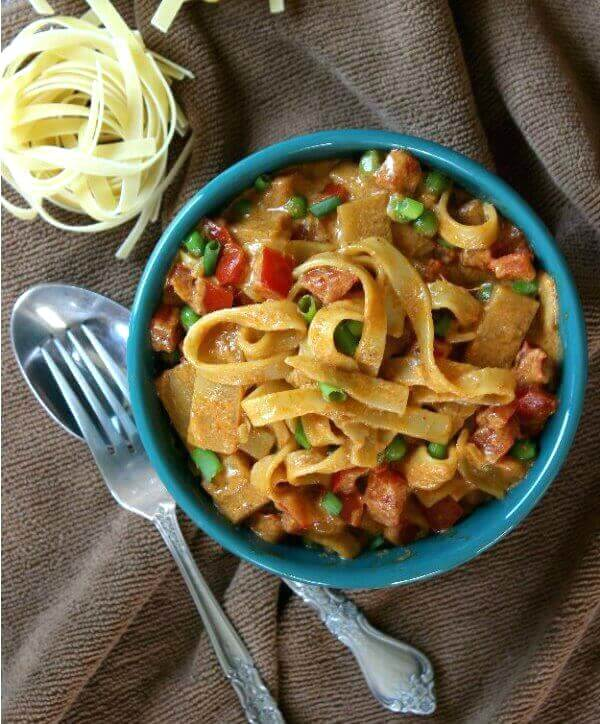 Curry pasta in a overhead photo with a fork and spoon on the side.