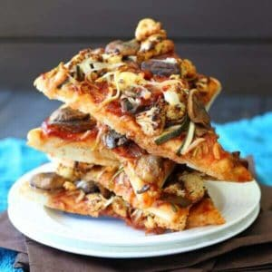Vegan BBQ Veggie Pizza is 5 slices stacked high at all angles with the toppings tempting everyone.