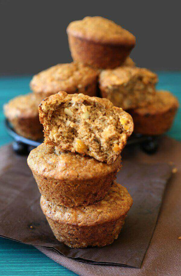 Vegan Apricot Muffins have little bits of sweet dried apricots inside along with finely chopped almonds. Simple and satisfying.